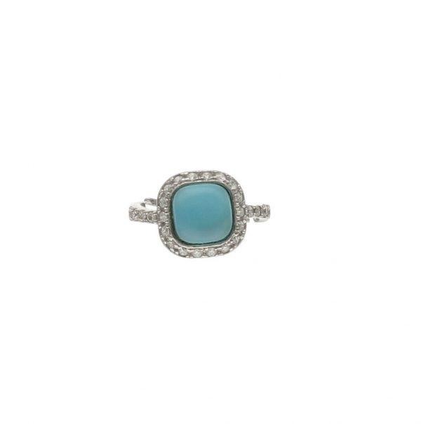Anello in argento con topazio azzurro cabochon e zirconi